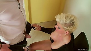 Tattooed blonde bombshell rides a big dick at a hotel