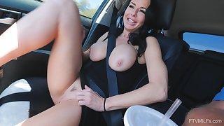 Solo MILF bombshell model Veronica masturbates in a car